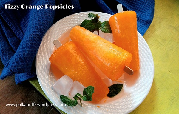 Fizzy Orange Popsicles Homemade Popsicles Polkapuff Popsicles Easy summer Popsicles How to make Popsicles at home Summer desserts Frozen dessert recipe